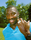 Washington Redskins quarterback Doug Williams shows off the ring he received for his team's 42 - 10 victory over the Denver Broncos in Super Bowl XXII at Redskins Park in Herndon, Virginia on August 5, 1988.  Williams was named the game's Most Valuable Player (MVP) as he led the team with 340 yards and four touchdowns.<br /> Credit: Arnie Sachs / CNP