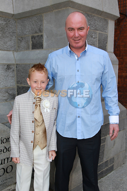 Greg Mitchell and Gregory Mitchell.at first communion for Gaelscoil an Bhradáin Feasa.Picture  www.newsfile.ie..