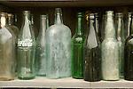 Super's Junkin Company. Old bottles on shelves.