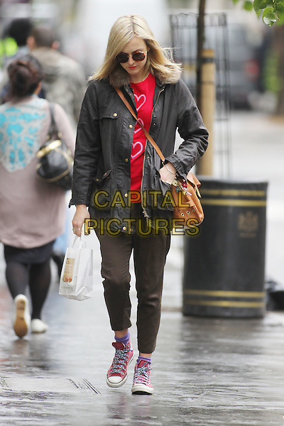 Fearne Cotton in central London, England..July 4th, 2012.full length sunglasses shades black jacket red pink hearts print top brown trousers converse trainers sneakers  fur collar brown leather satchel bag looking down.CAP/HIL.©John Hillcoat/Capital Pictures.