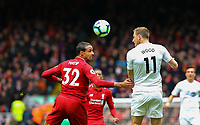 Burnley's Chris Wood vies for possession with Liverpool's Joel Matip<br /> <br /> Photographer Alex Dodd/CameraSport<br /> <br /> The Premier League - Liverpool v Burnley - Sunday 10th March 2019 - Anfield - Liverpool<br /> <br /> World Copyright © 2019 CameraSport. All rights reserved. 43 Linden Ave. Countesthorpe. Leicester. England. LE8 5PG - Tel: +44 (0) 116 277 4147 - admin@camerasport.com - www.camerasport.com