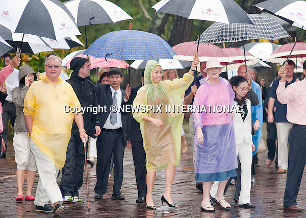 """Queen Margrethe, Crown Prince Fredrik and Crown Princess Mary and Prince Consort Henrik .The Danish Royal Family on their State Visit to Vietnam visit the Minh Manh Tomb in torrential downpour. The Hue area of Vietnam has experienced severe flooding and storms in the last 48 hours with many dead._Hue, Vietnam_05/11/2009..Mandatory Photo Credit: ©Dias/Newspix International..**ALL FEES PAYABLE TO: """"NEWSPIX INTERNATIONAL""""**..PHOTO CREDIT MANDATORY!!: NEWSPIX INTERNATIONAL(Failure to credit will incur a surcharge of 100% of reproduction fees)..IMMEDIATE CONFIRMATION OF USAGE REQUIRED:.Newspix International, 31 Chinnery Hill, Bishop's Stortford, ENGLAND CM23 3PS.Tel:+441279 324672  ; Fax: +441279656877.Mobile:  0777568 1153.e-mail: info@newspixinternational.co.uk"""