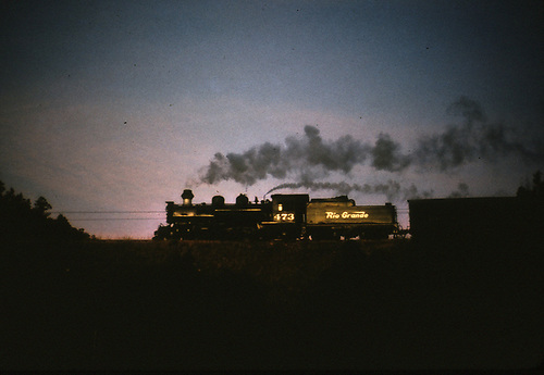 D&amp;RGW #473 with freight silhoutted against sunset.<br /> D&amp;RGW