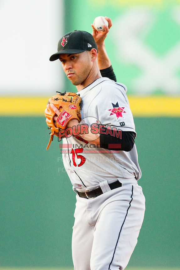 Indianapolis Indians second baseman Ivan DeJesus Jr. (15) makes a throw to first base against the Charlotte Knights at Knights Stadium on July 22, 2012 in Fort Mill, South Carolina.  The Indians defeated the Knights 17-1.  (Brian Westerholt/Four Seam Images)