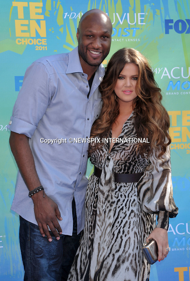 """KHLOE KARDASHIAN AND LAMAR ODOM.attends the Teen Choice 2011 at the Gibson Amphitheatre, Universal City, California_07/08/2011.Mandatory Photo Credit: ©Crosby/Newspix International. .**ALL FEES PAYABLE TO: """"NEWSPIX INTERNATIONAL""""**..PHOTO CREDIT MANDATORY!!: NEWSPIX INTERNATIONAL(Failure to credit will incur a surcharge of 100% of reproduction fees).IMMEDIATE CONFIRMATION OF USAGE REQUIRED:.Newspix International, 31 Chinnery Hill, Bishop's Stortford, ENGLAND CM23 3PS.Tel:+441279 324672  ; Fax: +441279656877.Mobile:  0777568 1153.e-mail: info@newspixinternational.co.uk"""