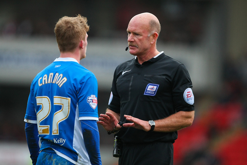 Referee Nigel Miller speaks to Rochdale's Andy Cannon.<br /> <br /> Photographer Alex Dodd/CameraSport<br /> <br /> Football - The Football League Sky Bet League One - Barnsley v Rochdale - Saturday 23rd January 2016 - Oakwell Stadium - Barnsley    <br /> <br /> &copy; CameraSport - 43 Linden Ave. Countesthorpe. Leicester. England. LE8 5PG - Tel: +44 (0) 116 277 4147 - admin@camerasport.com - www.camerasport.com