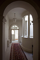 A corridor leading past the palladian atrium