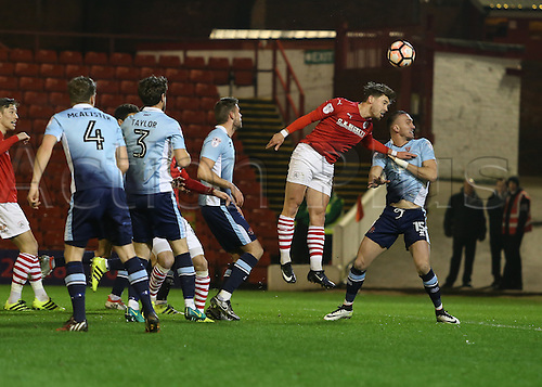 17th January 2017, Oakwell, Barnsley, South Yorkshire, England; FA Cup 3rd round replay, Barnsley versus Blackpool; Barnsley's Tom Bradshaw attempts a header on goal, as Tom Aldred defends