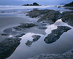 Olympic National Park, WA:  Silver light at dusk plays on the tide pools and seastacks of Ruby Beach