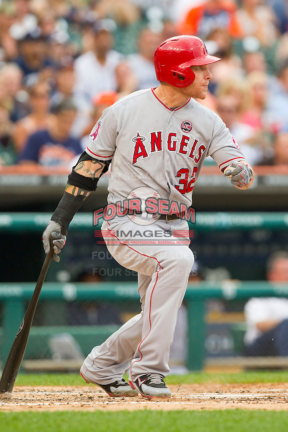 Josh Hamilton (32) of the Los Angeles Angels follows through on his swing against the Detroit Tigers at Comerica Park on June 25, 2013 in Detroit, Michigan.  The Angels defeated the Tigers 14-8.  (Brian Westerholt/Four Seam Images)