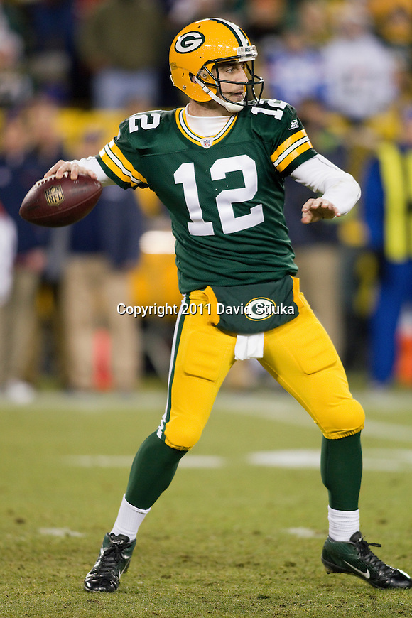 Green Bay Packers quarterback Aaron Rodgers (12) throws a pass during a week 16 NFL football game against the Chicago Bears on December 25, 2011 in Green Bay, Wisconsin. The Packers won 35-21. (AP Photo/David Stluka)