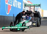 Feb 3, 2016; Chandler, AZ, USA; Crew members with NHRA top fuel driver Leah Pritchett during pre season testing at Wild Horse Pass Motorsports Park. Mandatory Credit: Mark J. Rebilas-USA TODAY Sports