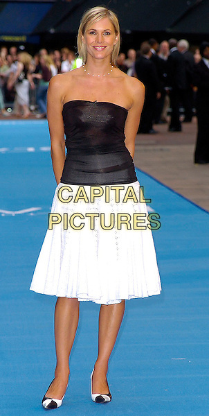 "JENNI FALCONER.""The Island"" UK Film Premiere, Odeon Leicester Square, WC2.August 7th, 2005.full length white skirt black strapless top arms behind back.www.capitalpictures.com.sales@capitalpictures.com.©Capital Pictures"