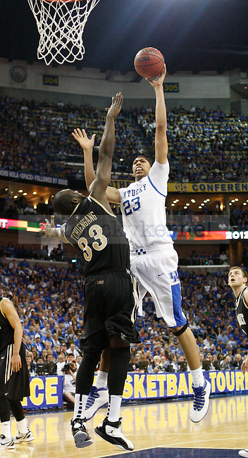 UK forward Anthony Davis shoots the ball over Vanderbit's Steve Tchiengang during the second half in the 2012 SEC Tournament championship game between Kentucky and Vanderbilt, played at New Orleans Arena, on 3/11/12.  Photo by Quianna Lige | Staff