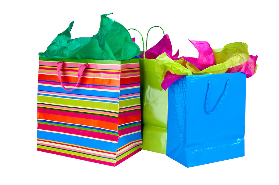 Close up of shopping bags with colorful tissue paper.