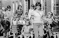 Following the disappearance on 2nd September 1973 of 10 year old Belfast boy, Brian McDermott, there was a noticable increase in the number of adults picking up children at Brian's school. Brian's body, mutilated and burnt, was recovered from the River Lagan about a week later. 197309020583a<br />