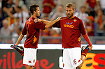 Calcio, Serie A: Roma-Catania. Roma, stadio Olimpico, 26 agosto 2012..AS Roma midfielders Miralem Pjanic, of Bosnia, left, and Daniele De Rossi warm up prior to the start of the Italian Serie A football match between AS Roma and Catania, at Rome, Olympic stadium, 26 August 2012. .UPDATE IMAGES PRESS/Isabella Bonotto