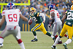 Green Bay Packers quarterback Aaron Rodgers (12) scrambles out of the pocket during an NFL divisional playoff football game against the New York Giants on January 15, 2012 in Green Bay, Wisconsin. The Giants won 37-20. (AP Photo/David Stluka)