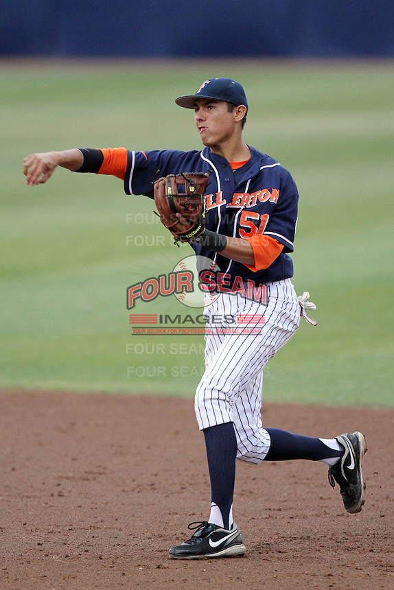 Greg Velazquez #51 of the Cal. St. Fullerton Titans makes a throw against the Cal. St. Long Beach 49'ers at Goodwin Field in Fullerton,California on May 14, 2011. Photo by Larry Goren/Four Seam Images