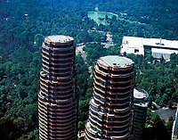 aerial photograph of Coca residential towers, Polanco, Mexico City, Mexico, part of the Del Bosqque complex designed by Pelli Clarke Pelli architects with Chapultepek park and the National Museum of Anthropology in the background