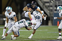 MIAMI, FL - OCTOBER 14:  FIU quarterback Alex McGough (12) leaps over Tulane safety Roderic Teamer Jr. (2) while carrying the ball in the third quarter as the FIU Golden Panthers defeated the Tulane University Green Wave, 23-10, on October 14, 2017, at Riccardo Silva Stadium in Miami, Florida.