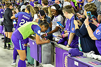 Orlando, FL - Saturday March 24, 2018: Orlando Pride defender Poliana Barbosa Medeiros (19) signs an auto for a fan after a regular season National Women's Soccer League (NWSL) match between the Orlando Pride and the Utah Royals FC at Orlando City Stadium. The game ended in a 1-1 draw.