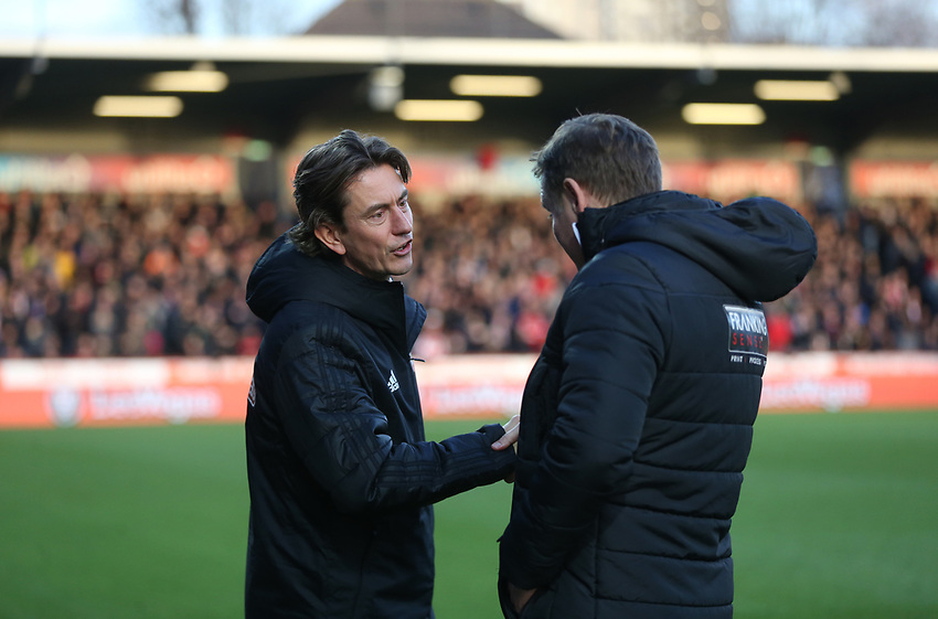 Brentford manager Thomas Frank shakes hands with Bolton Wanderers manager Phil Parkinson prior to kick-off<br /> <br /> Photographer Rob Newell/CameraSport<br /> <br /> The EFL Sky Bet Championship - Brentford v Bolton Wanderers - Saturday 22nd December 2018 - Griffin Park - Brentford<br /> <br /> World Copyright © 2018 CameraSport. All rights reserved. 43 Linden Ave. Countesthorpe. Leicester. England. LE8 5PG - Tel: +44 (0) 116 277 4147 - admin@camerasport.com - www.camerasport.com