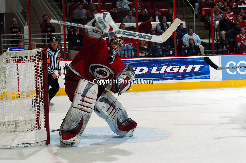 Carolina Hurricanes' goaltender Cam Ward makes a blocker save against the New York Islanders during their game Thursday, Jan. 19, 2006 in Raleigh, NC. Carolina won 4-3.