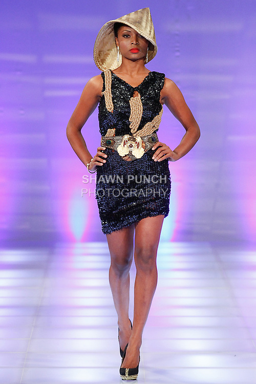 Model walks runway in an outfit from the Cory Couture collection, by Cory Dung Tran, during Couture Fashion Week in New York, September 8, 2013.