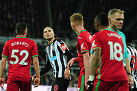 Jonjo Shelvey of Newcastle United and Jordan Ayew of Swansea City (r) have words during Newcastle United vs Swansea City, Premier League Football at St. James' Park on 13th January 2018