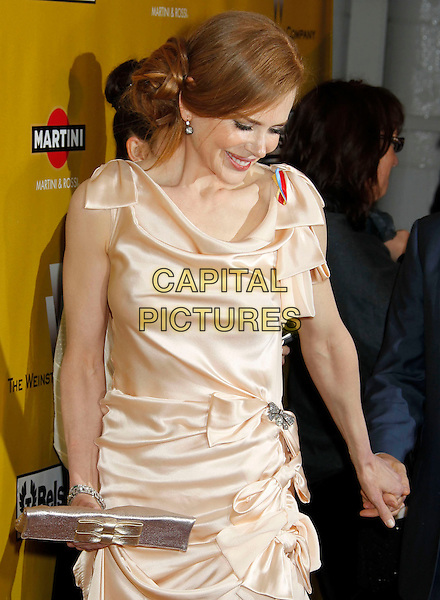 NICOLE KIDMAN.Weinstein Company Post Golden Globe Party held at Bar210 & Plush Ultra Lounge at the Beverly Hilton Hotel, Beverly Hills, California, USA..January 17th, 2009.globes half length pink beige silk satin dress clutch bag brooch gathered cream beige.CAP/ADM/MJ.©Michael Jade/Admedia/Capital Pictures
