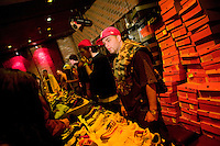 Vendors sell their products during Dunkxchange, a market held in a club in New York City, USA, where sneaker collectors trade and sell their rare shoes, 7 January 2007.<br />