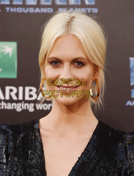HOLLYWOOD, CA - JULY 17:  Model Poppy Delevingne arrives at the Premiere Of EuropaCorp And STX Entertainment's 'Valerian And The City Of A Thousand Planets' at TCL Chinese Theatre on July 17, 2017 in Hollywood, California.<br /> CAP/ROT/TM<br /> &copy;TM/ROT/Capital Pictures