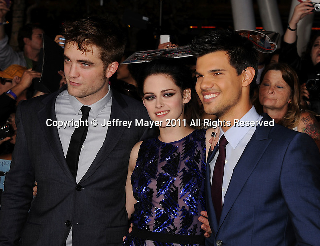"LOS ANGELES, CA - NOVEMBER 14: Robert Pattinson, Kristen Stewart and Taylor Lautner arrive at the Los Angeles premiere of ""The Twilight Saga: Breaking Dawn Part 1"" held at Nokia Theatre L.A. Live on November 14, 2011 in Los Angeles, California."