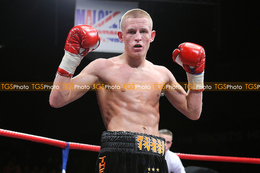 Terry Flannigan (black/orange shorts) defeats Lewis Browning in a Super-Flyweight boxing contest at the Brentwood Centre, promoted by Frank Maloney - 05/02/11 - MANDATORY CREDIT: Gavin Ellis/TGSPHOTO - Self billing applies where appropriate - Tel: 0845 094 6026