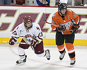 Pat Gannon 13 of Boston College and Brandon Svendsen 23 of Bowling Green head into play. The Eagles of Boston College defeated the Falcons of Bowling Green State University 5-1 on Saturday, October 21, 2006, at Kelley Rink of Conte Forum in Chestnut Hill, Massachusetts.<br />