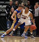 OMAHA, NE - January 10, 2015 -- Tre'Shawn Thurman (15) drives into South Dakota State defender Lane Severyn (25) during the first half of their game Saturday evening at the Ralston Arena in Ralston, NE. (Photo By Ty Carlson / DakotaPress)