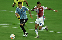 ARMENIA – COLOMBIA, 19-01-2020: Maximiliano Araujo de Uruguay disputa el balón con Rodi Ferreira de Paraguay durante partido entre Uruguay y Paraguay por la fecha 1, grupo B, del CONMEBOL Preolímpico Colombia 2020 jugado en el estadio Centenario de Armenia, Colombia. /  Maximiliano Araujo of Uruguay fights the ball with Rodi Ferreira of Paraguay during the match between Colombia and Paraguay for the date 1, group B, for the CONMEBOL Pre-Olympic Tournament Colombia 2020 played at Centenario stadium in Armenia, Colombia. Photos: VizzorImage / Gabriel Aponte / Staff