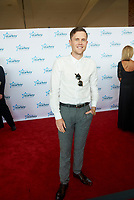 "ST. PAUL, MN JULY 16: 2016 American Idol winner Trent Harmon poses on the red carpet at the Starkey Hearing Foundation ""So The World May Hear Awards Gala"" on July 16, 2017 in St. Paul, Minnesota. Credit: Tony Nelson/Mediapunch"