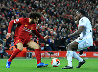 24th February 2020; Anfield, Liverpool, Merseyside, England; English Premier League Football, Liverpool versus West Ham United; Mohammed Salah of Liverpool  takes on Michail Antonio of West Ham United