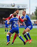 Lincoln City's Matt Green vies for possession with Chesterfield's Andy Kellett and Ian Evatt<br /> <br /> Photographer Andrew Vaughan/CameraSport<br /> <br /> The EFL Sky Bet League Two - Lincoln City v Chesterfield - Saturday 7th October 2017 - Sincil Bank - Lincoln<br /> <br /> World Copyright &copy; 2017 CameraSport. All rights reserved. 43 Linden Ave. Countesthorpe. Leicester. England. LE8 5PG - Tel: +44 (0) 116 277 4147 - admin@camerasport.com - www.camerasport.com