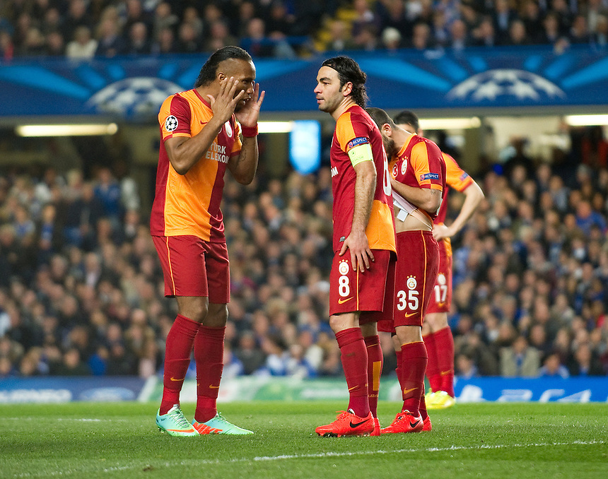 Galatasaray's Didier Drogba with team-mate Selcuk İnan<br /> <br /> Photo by Ashley Western/CameraSport<br /> <br /> Football - UEFA Champions League First Knockout Round 2nd Leg - Chelsea v Galatasaray - Tuesday 18th March 2014 - Stamford Bridge - London<br />  <br /> &copy; CameraSport - 43 Linden Ave. Countesthorpe. Leicester. England. LE8 5PG - Tel: +44 (0) 116 277 4147 - admin@camerasport.com - www.camerasport.com