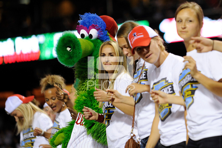 The Philadelphia Phillies mascot the Phillie Phanatic dances on top of the Phillies dugout with members of the Womens Professional Soccer team the Philadelphia Independence during the seventh inning against the St. Louis Cardinals at Citizens Bank Park in Philadelphia, PA on May 4, 2010. The Phillies defeated the Cardinals 2-1 in ten innings. Mandatory Credit: Howard Smith-ISIPhotos.com/US PRESSWIRE