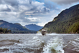 CANADA, Vancouver, British Columbia, a boat flies through the chop in front of Gambier Island in the Howe Sound
