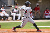 Dayan Viciedo #24 of the Birmingham Barons follows through on his swing versus the Carolina Mudcats at Five County Stadium August 16, 2009 in Zebulon, North Carolina. (Photo by Brian Westerholt / Four Seam Images)