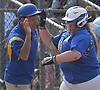 Christina Loeffler #45 of East Meadow gets congratulated by head coach Stu Fritz after connecting for a solo home run in the bottom of the third inning of Game 3 of the Nassau County varsity softball Class AA final against Long Beach at Mitchel Athletic Complex on Friday, May 26, 2017. The homer extended the Jets' lead to 3-1. East Meadow went on to win by that same score to take the best-of-three series two games to one.