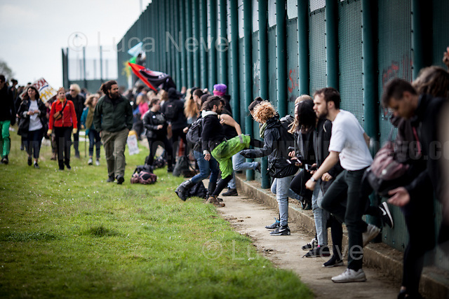 Bedford (Bedfordshire, England), 13/05/2017. Today, more than two thousand activists and members of the public from across the UK gathered outside the notorious Yarl's Wood I.R.C. Immigration Removal Centre in Bedfordshire, lead by the &quot;Movement for Justice By Any Means Necessary&quot; to protest against the alleged inhuman conditions of the 400+ detainees (showed in a Channel 4 undercover investigation - http://bit.ly/1E6X4pz) and to call for immediate closure of all detention centres. &lt;&lt;Yarl's Wood Immigration Removal Centre is a detention centre for foreign nationals prior to their deportation from the United Kingdom, one of 13 such centres currently in the UK. It is located near Milton Ernest in Bedfordshire, England, and is operated by Serco (British outsourcing company based in Hook, Hampshire. It operates public and private transport and traffic control, aviation, military weapons, detention centres, prisons and schools on behalf of its customers - Source Wikipedia.org), who describes the place as &quot;a fully contained residential centre housing adult women and adult family groups awaiting immigration clearance.&quot; Its population is, and has been, overwhelmingly female. [&hellip;] &gt;&gt; (Source - Wikipedia.org at http://bit.ly/1GiTFWB). The protest of today was the 11th demo organised at Yarl's Wood and the largest ever at a detention centre in the UK. Mabel Gawanas, 43 - the longest-serving detainee at Yarl's Wood: three years - attended the demo, gave a speech and chatted on the phone offering her support and solidarity with the people detained (For an article about Mabel Gawanas please click here: https://goo.gl/3JCTCB - Source, Bedfordshire On Sunday).<br />