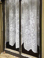 New lace curtains grace an old window at Bille Creek Village, a historic recreation of nineteenth century life in Indiana, Rockville, Indiana