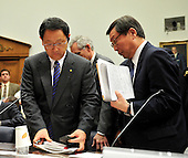 Washington, D.C. - February 24, 2010 --  Akio Toyoda, President and CEO, Toyota Motor Corporation, left, and Yoshimi Inaba, President and CEO, Toyota Motor North America, Inc., right, depart following their testimony before the U.S. House Committee on Government and Reform examining the Federal government's response to the recall of millions of Toyota vehicles due to reports of malfunctioning gas pedals, and to gain a better understanding of the nature of the sudden acceleration problem in Toyota vehicles and what should be done about it.  .Credit: Ron Sachs / CNP.(RESTRICTION: NO New York or New Jersey Newspapers or newspapers within a 75 mile radius of New York City)