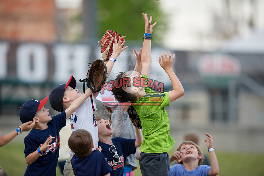 Chattanooga Lookouts young fans try to catch a ball tossed up by Brantley Bell (not shown) before a Southern League game against the Birmingham Barons on May 2, 2019 at Regions Field in Birmingham, Alabama.  Birmingham defeated Chattanooga 4-2.  (Mike Janes/Four Seam Images)